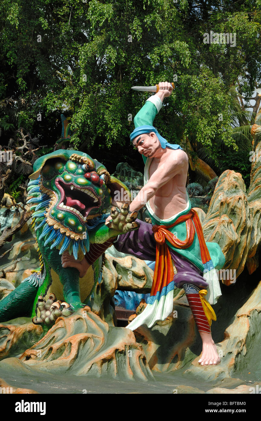 Dragon Slayer Killing a Chinese Dragon, Tiger Balm Gardens Chinese Theme Park, Singapore - Stock Image