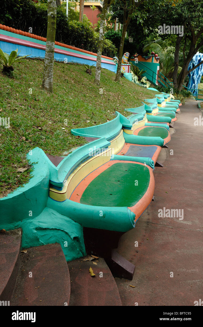 Mulicolored or Multicoloured Painted Concrete Park Bench, Benches or Seats, Tiger Balm Gardens Chinese Theme Park, - Stock Image