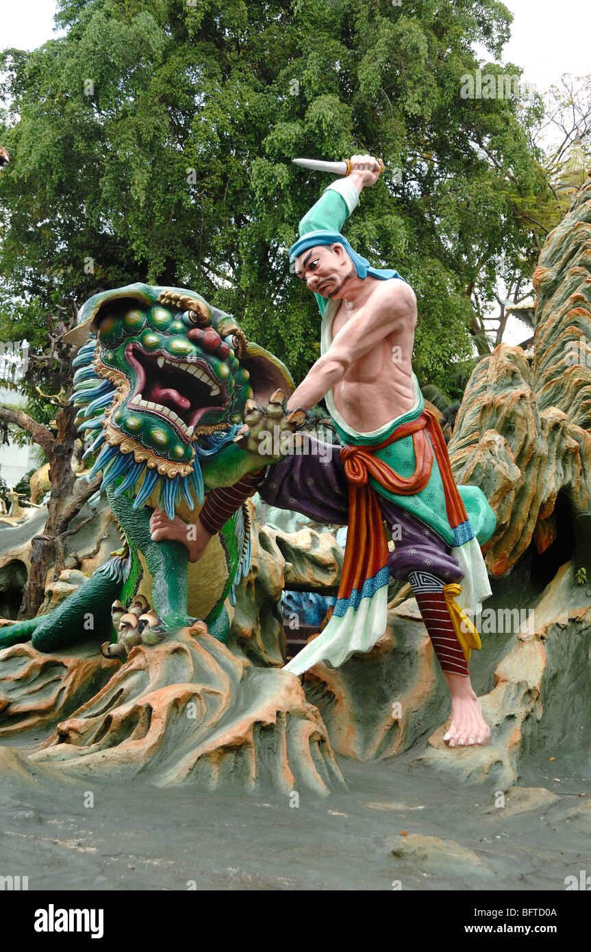 Dragon Slayer Killing Chinese Dragon, Tiger Balm Gardens Chinese Theme Park, Singapore - Stock Image