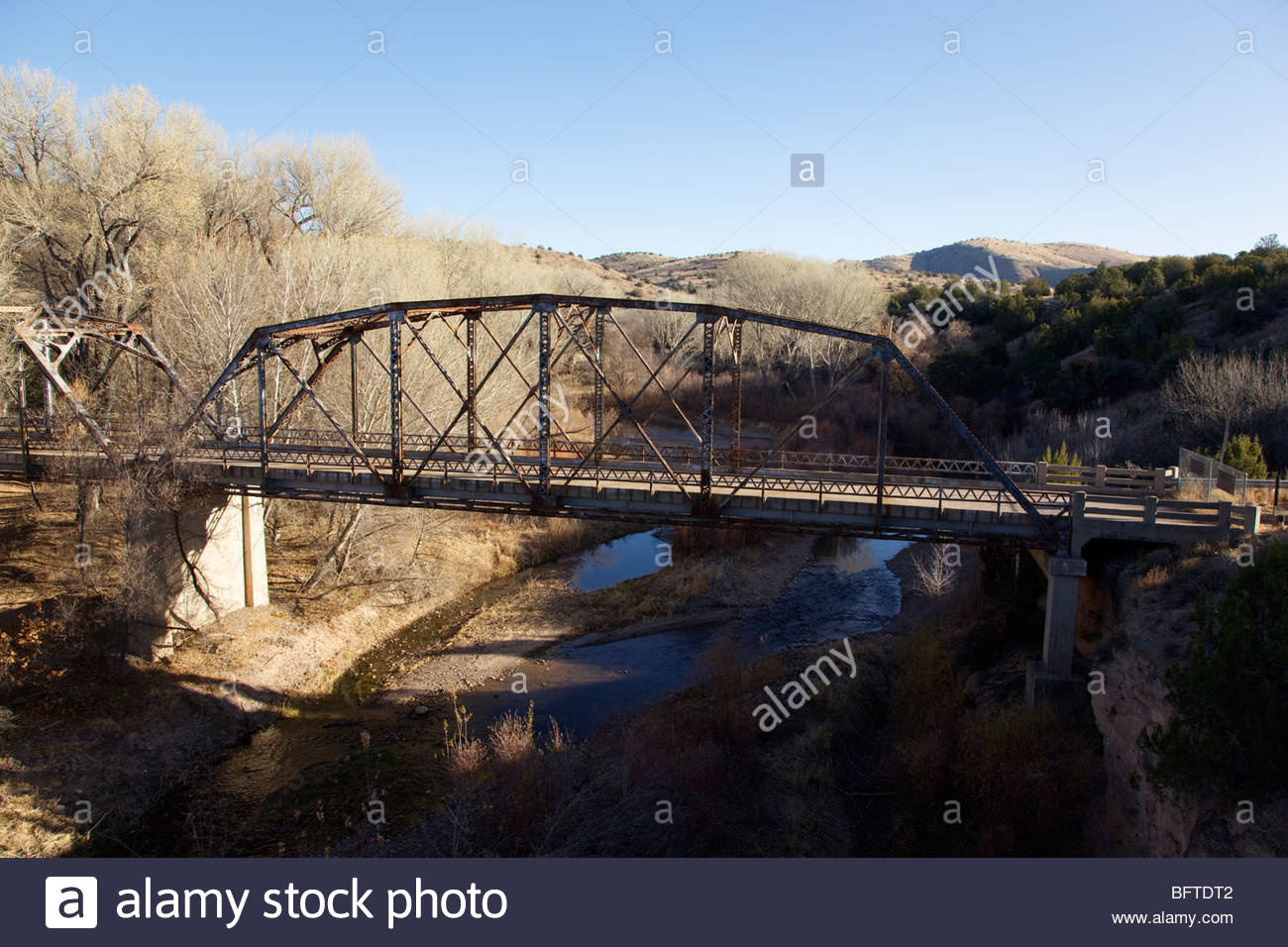 """Old abandoned steel truss highway bridge US 180 over San Francisco River """"New Mexico"""" Stock Photo"""
