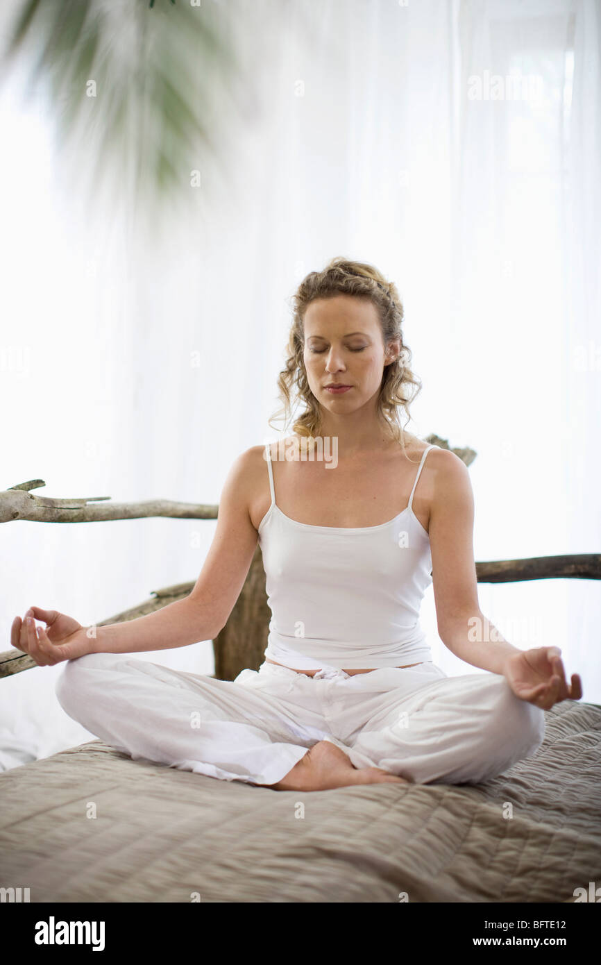 middle-aged woman doing yoga - Stock Image