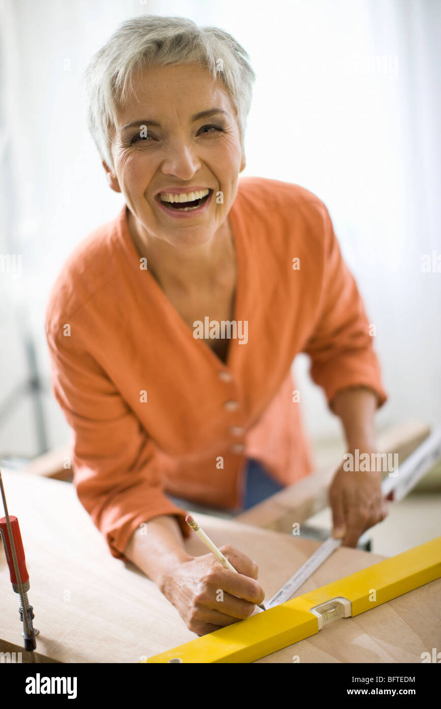 woman doing mechanical skills - Stock Image