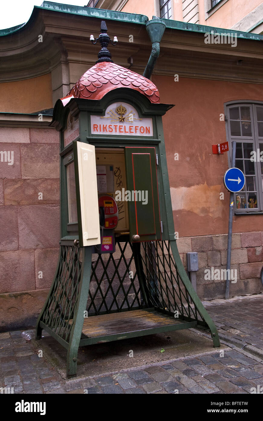 A public telephone box in Gamla San Stockholm - Stock Image