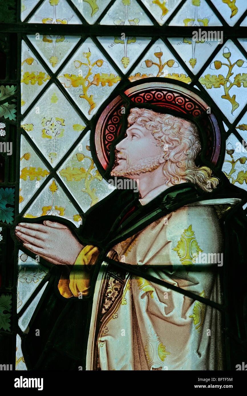 Detail of a stained glass window depicting St John, by Charles Eamer Kempe, Stratford Tony, Wiltshire - Stock Image