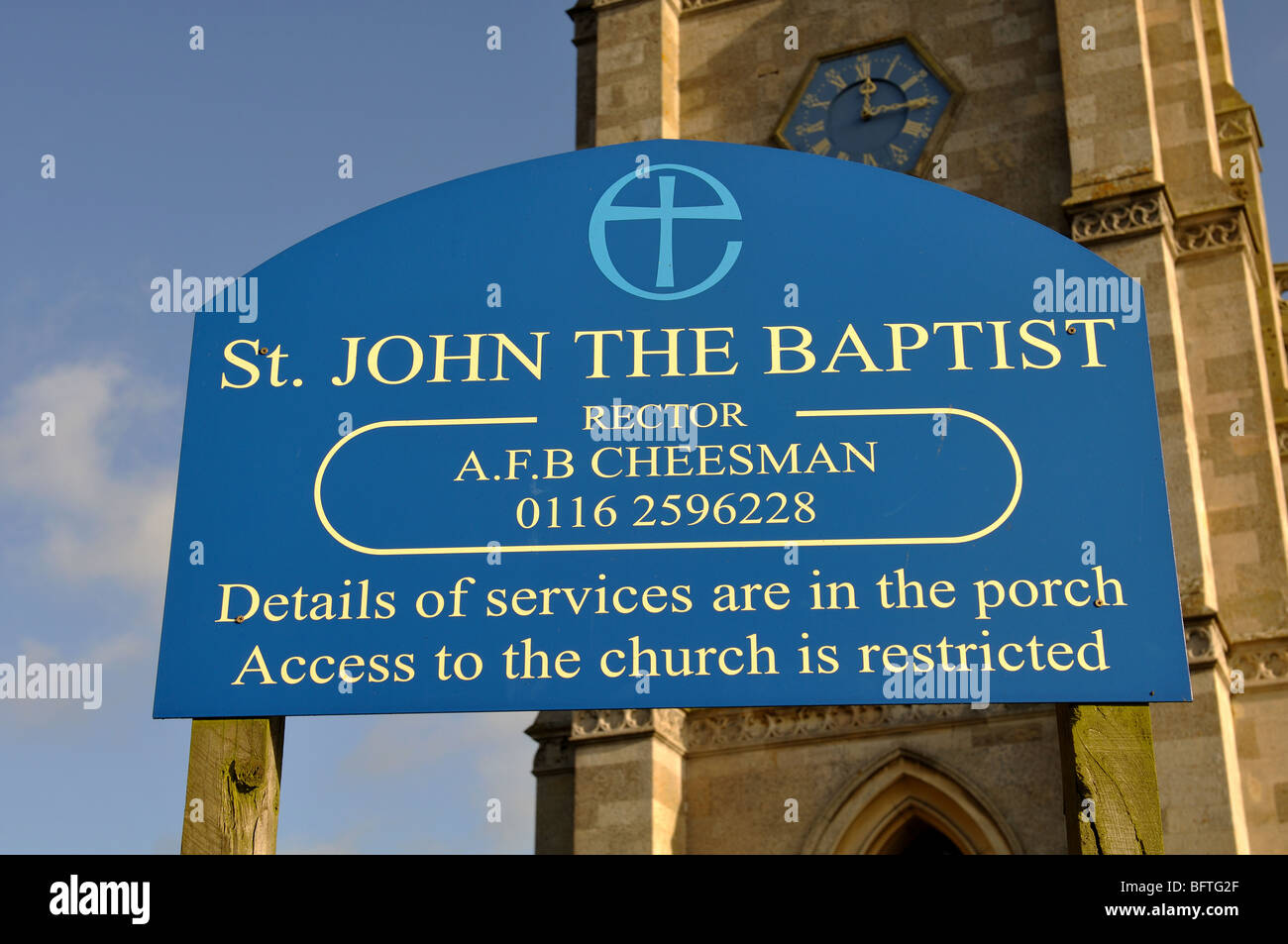 Sign of St. John the Baptist Church, King`s Norton, Leicestershire, England, UK - Stock Image