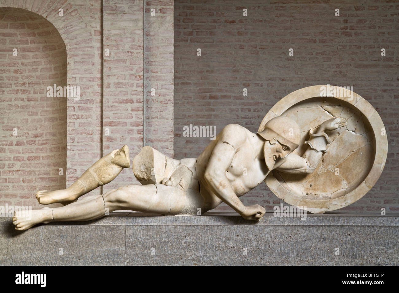 Dying warrior from the east pediment of the Temple of Aphaia at Aegina, ca. 480 BC. Depiction of the Trojan war. - Stock Image