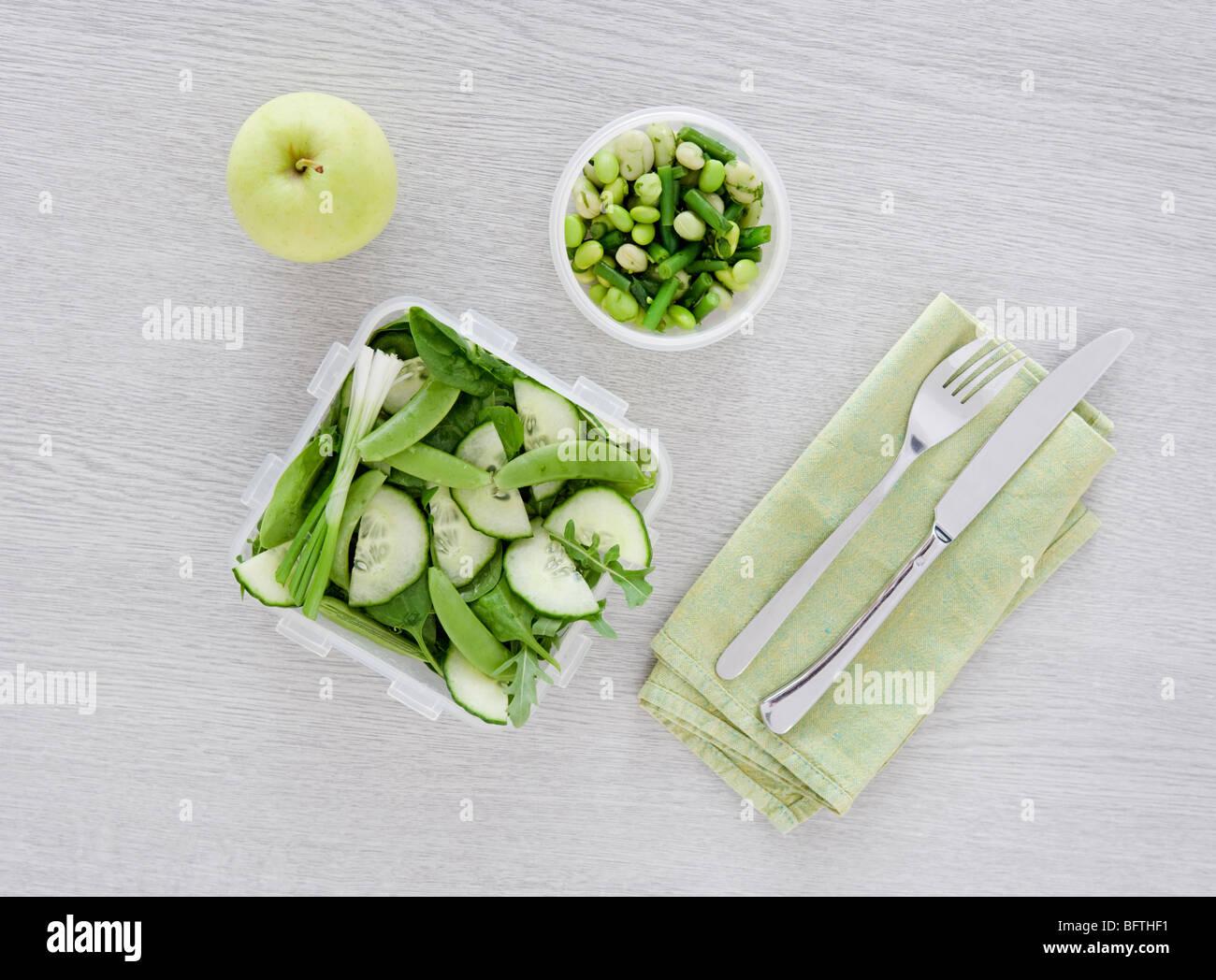 salad on desk - Stock Image