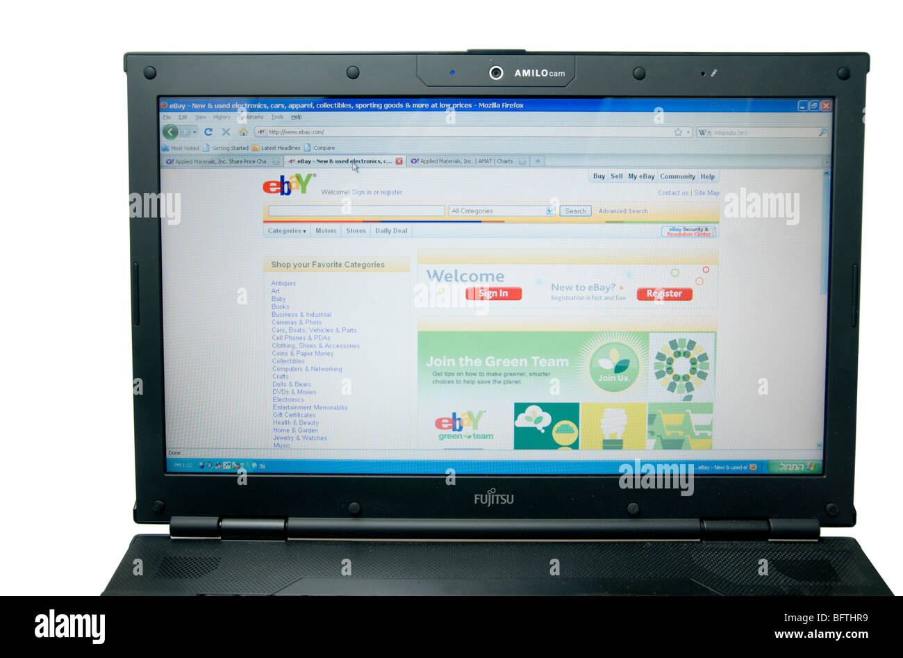 Cutout Of A Laptop Computer Screen Showing An Ebay Auction On White Stock Photo Alamy