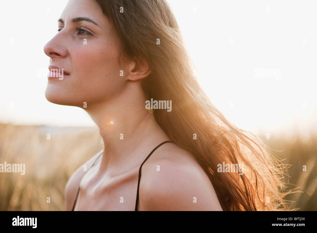 woman strolling through reed - Stock Image