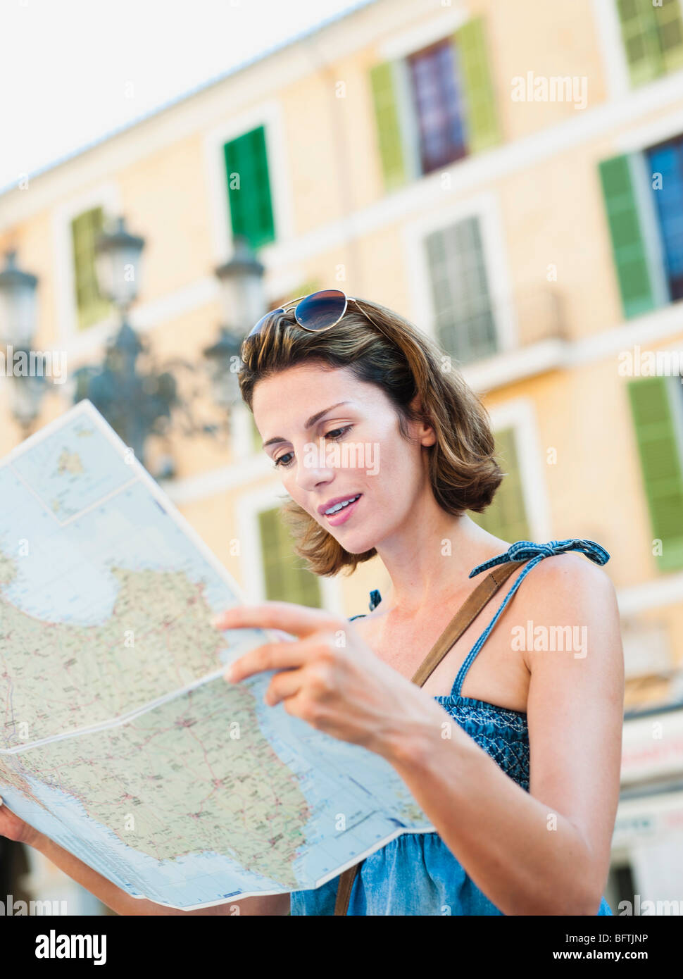 woman looking at a map Stock Photo