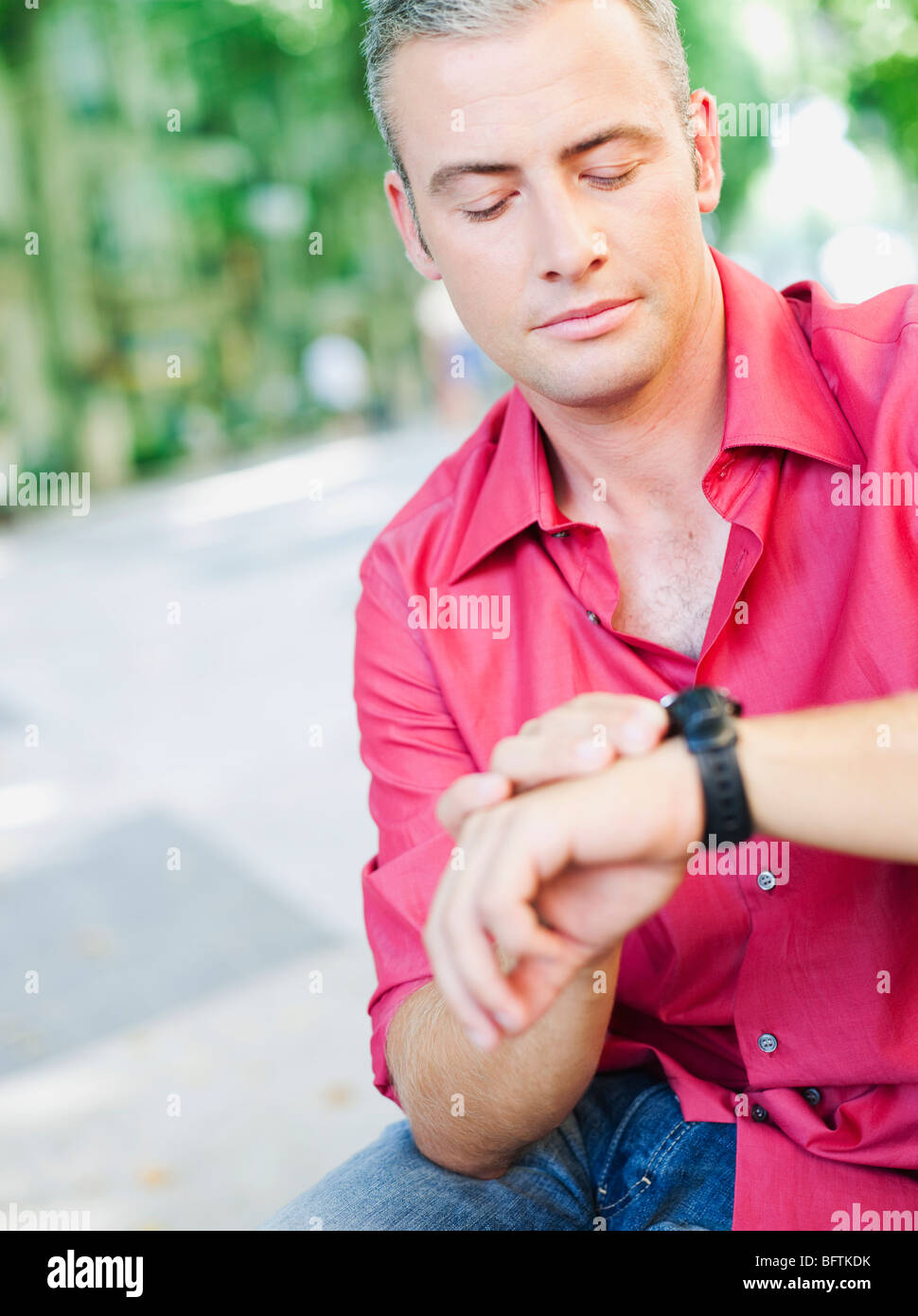 man looking at his watch - Stock Image