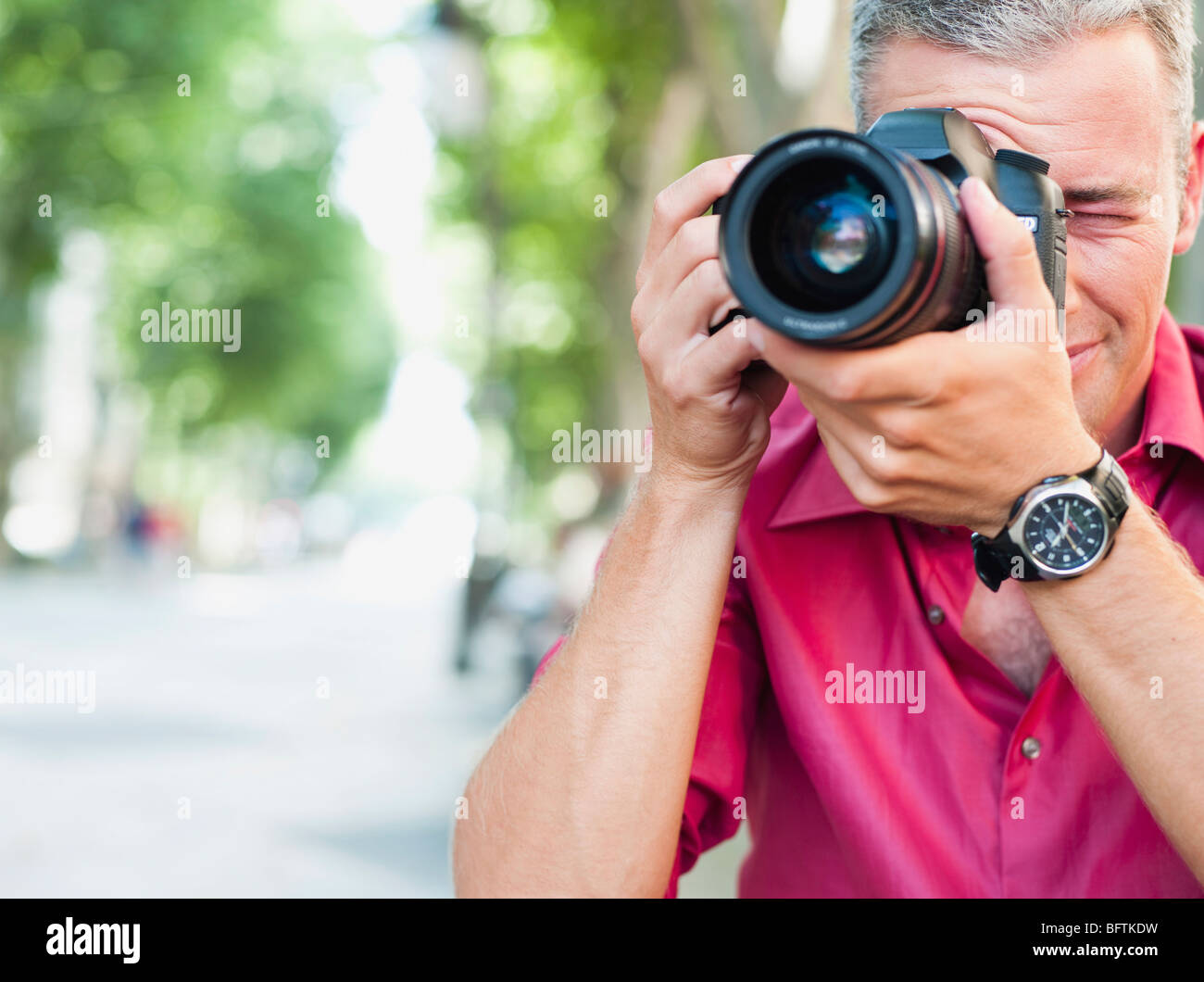 man with camera taking picture - Stock Image