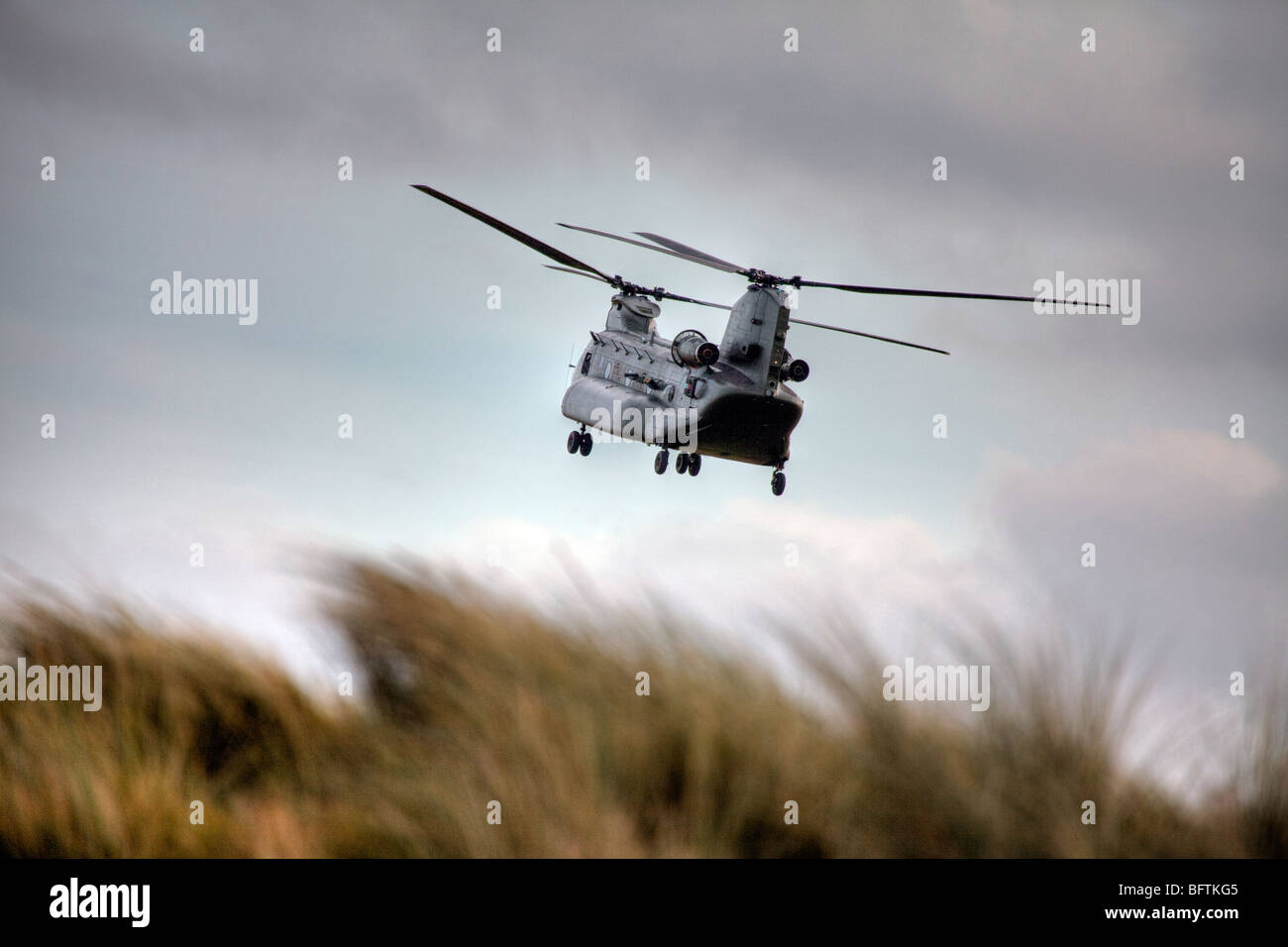 Donna Nook, Lincolnshire is the ideal place for a free air show from the RAF this Chinook flew over many times - Stock Image