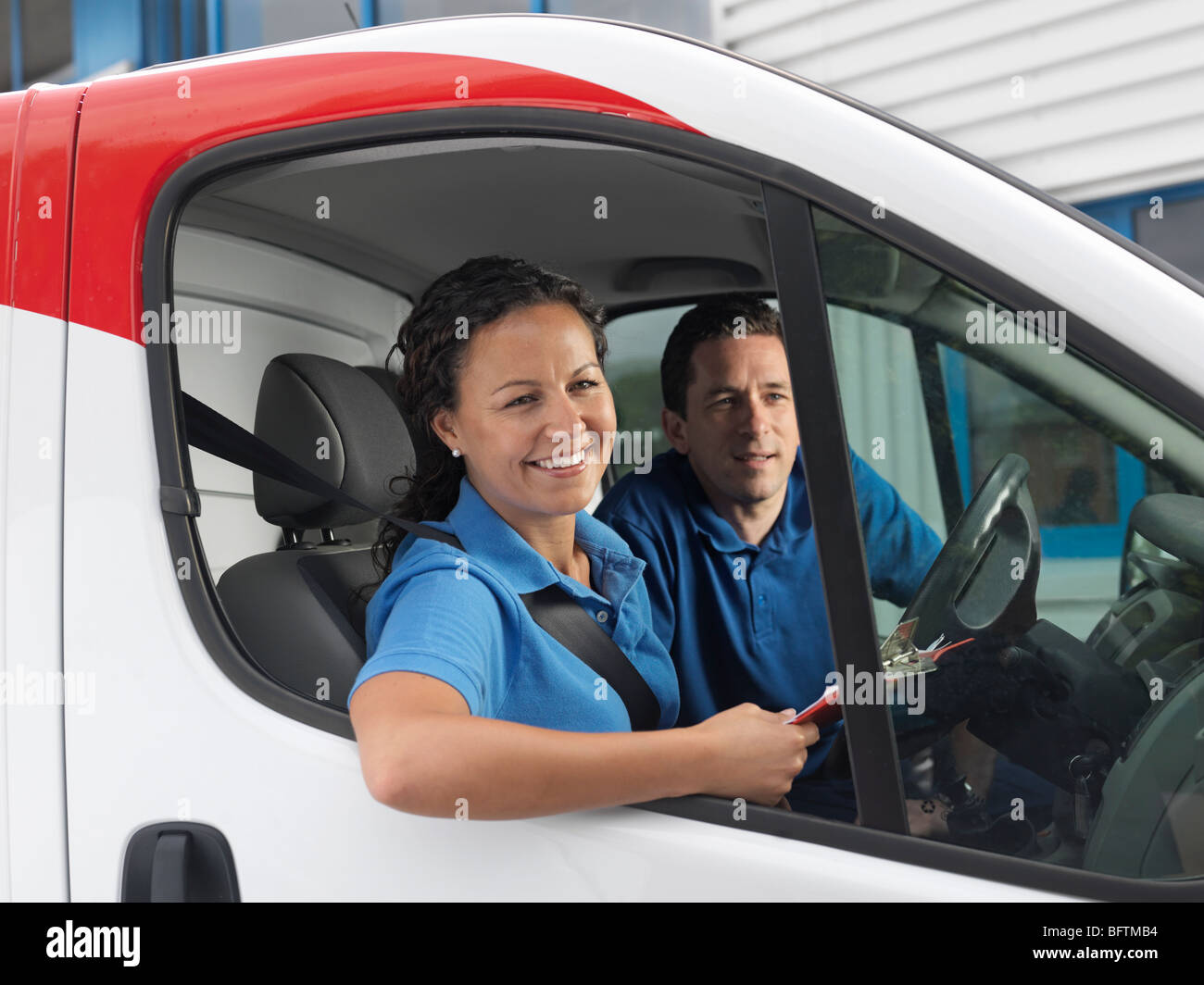 man and woman in delivery van - Stock Image