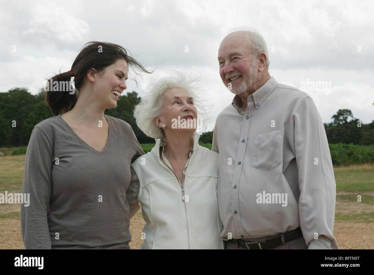 Elderly couple with granddaughter - Stock Image