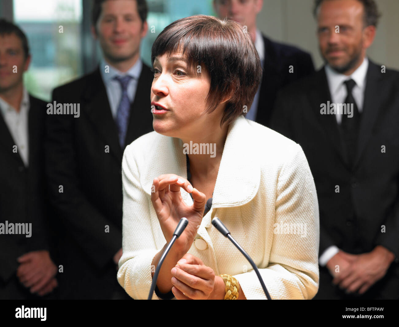 Business woman giving a conference - Stock Image