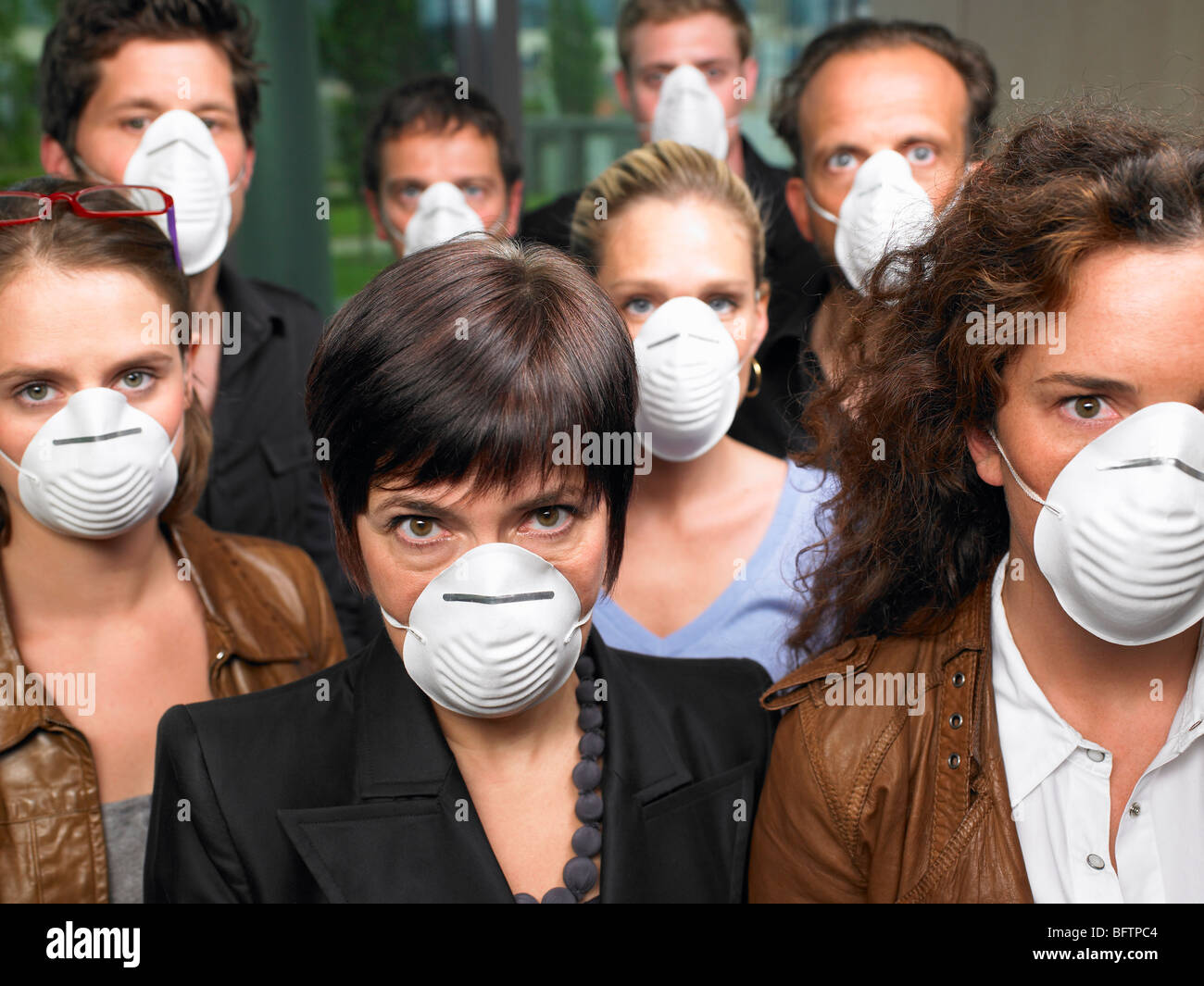 Group of people wearing protection masks - Stock Image