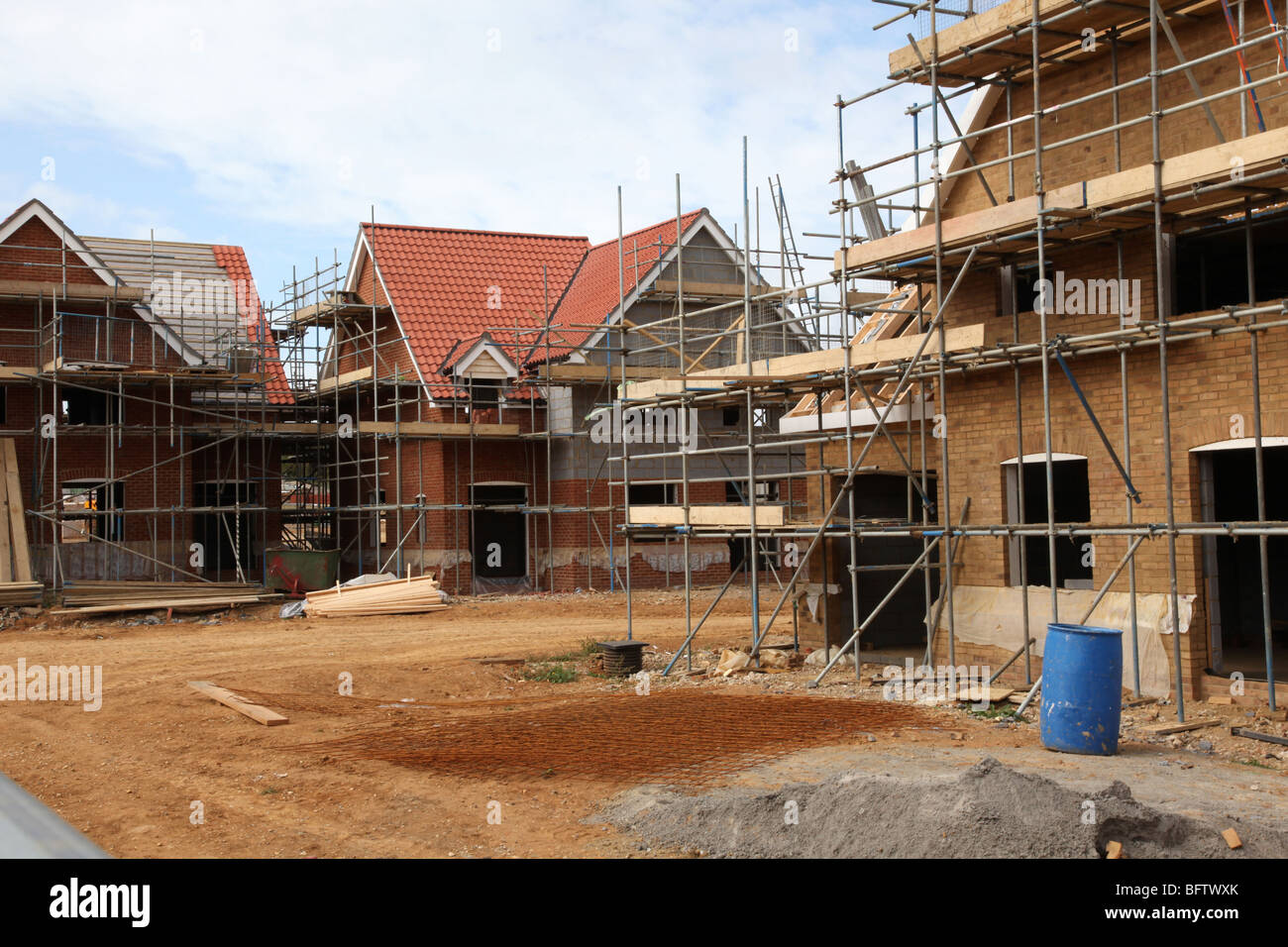 New houses under constuction on a building site - Stock Image