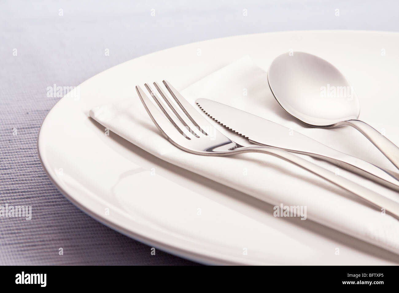 silverware on plate - Stock Image