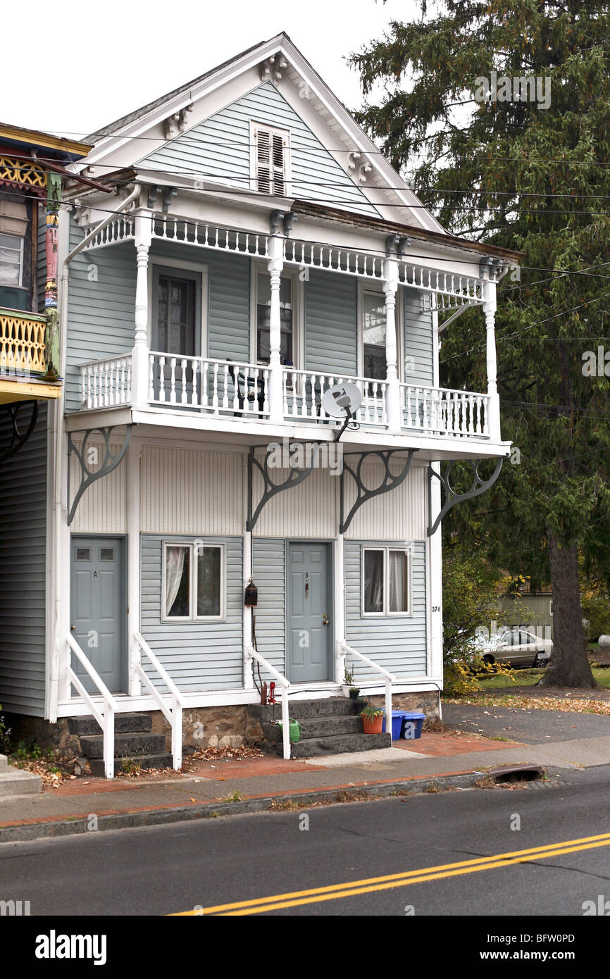 pale blue Victorian house in Rosendale NY with elaborate 2nd floor balcony & ground floor altered for duplex - Stock Image