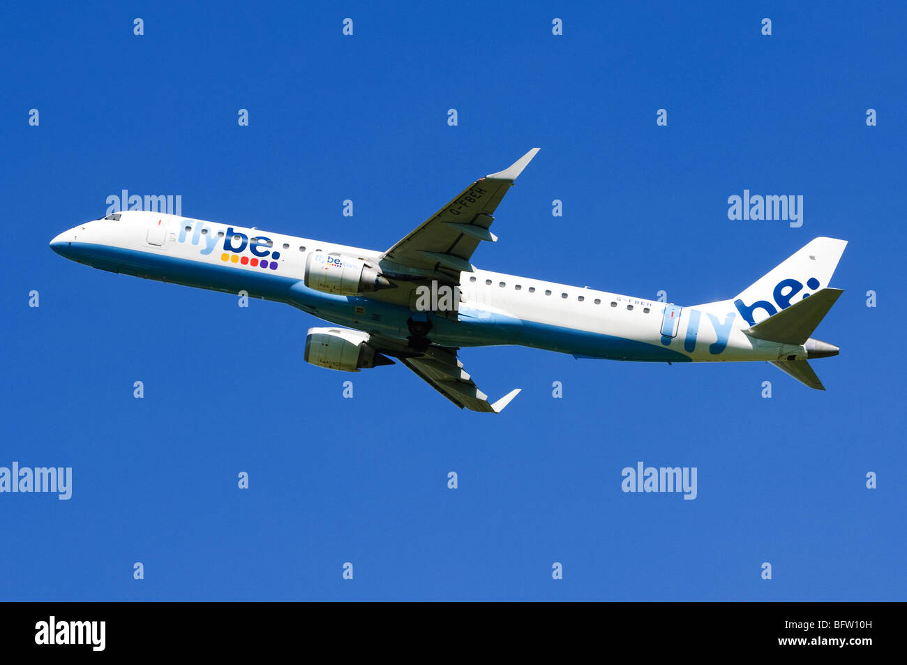 Embraer ERJ-190 operated by Flybe climbing out from take off at Birmingham Airport, UK. - Stock Image