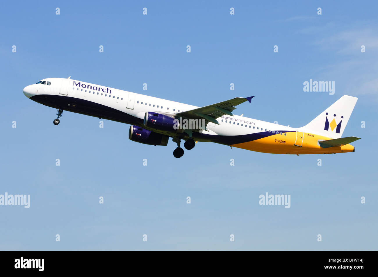Airbus A321 operated by Monarch Airlines climbing out from take off at Birmingham Airport, UK. Stock Photo