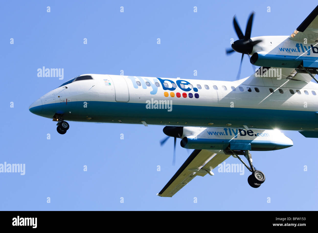 Bombardier Dash 8 operated by Flybe on approach for landing at Birmingham Airport, UK. - Stock Image