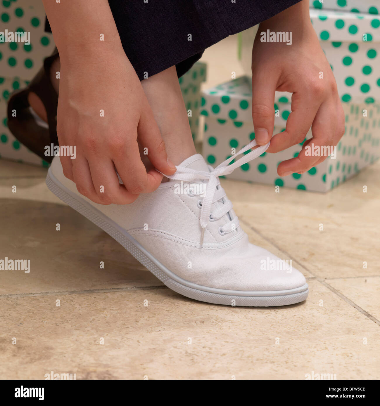 Putting on a shoe - Stock Image