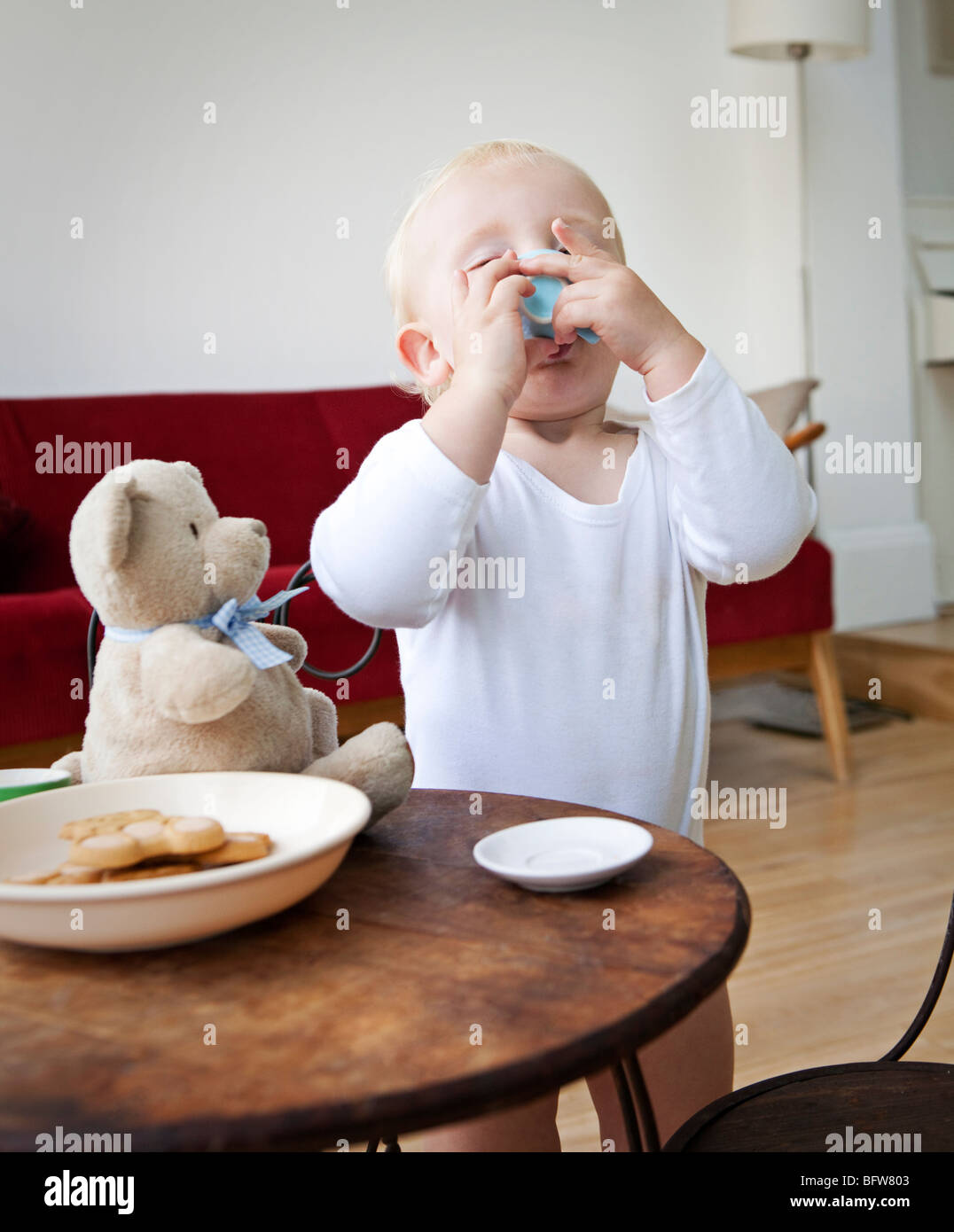 Boy toddler having a pretend cup of tea - Stock Image