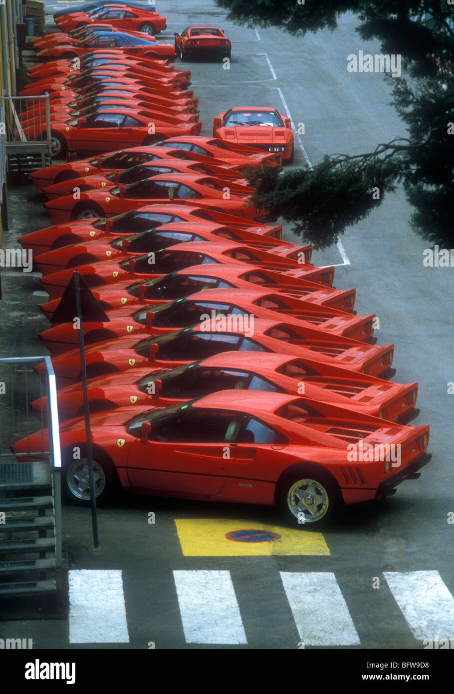 31 examples of  288 GTO Ferrari's parked at the Marenello factory 1984 - Stock Image