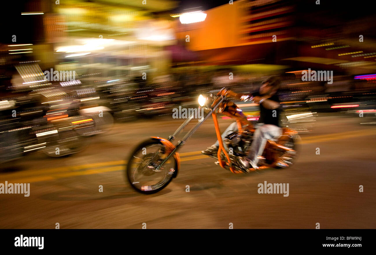 Chopper at speed Main Street  Daytona at night - Stock Image