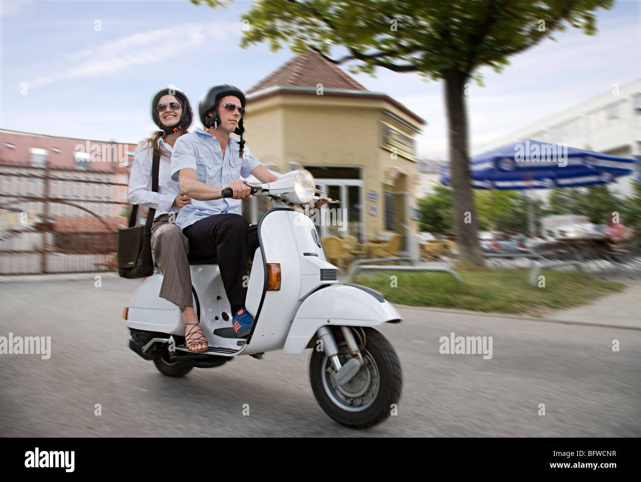 couple on scooter - Stock Image