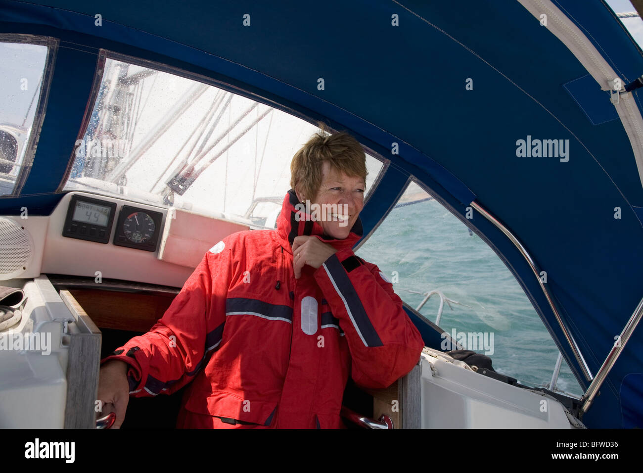 Woman sheltering on yacht - Stock Image