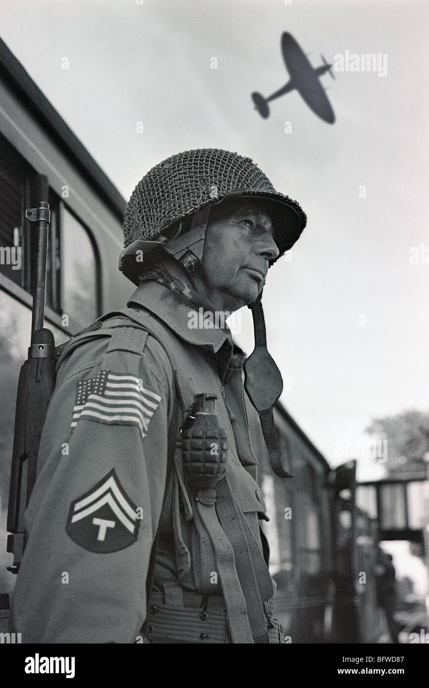 World War Two American GI standing on railway station platform (member of re-enactment group at 1940s fayre) - Stock Image