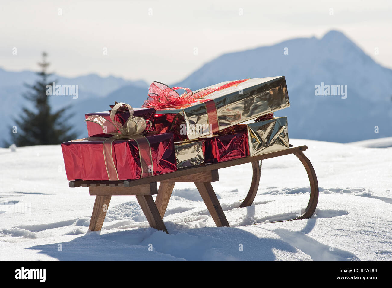 Sleigh with presents in snowy landscape - Stock Image