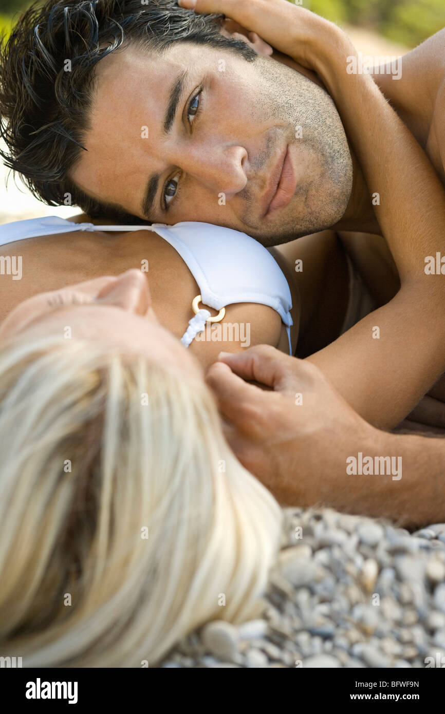A male resting his head on a female - Stock Image