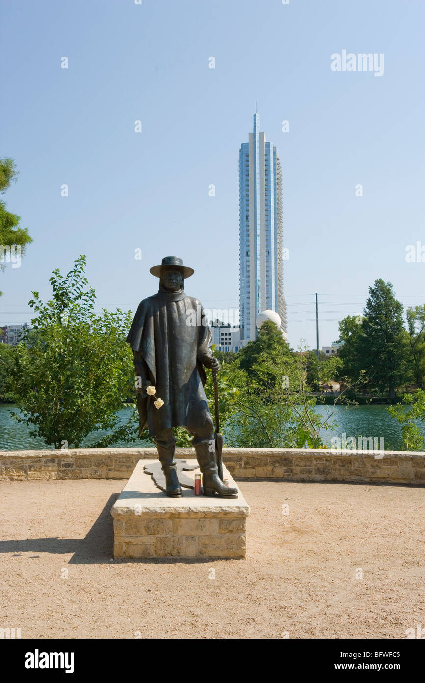 Austin skyline with statue of Stevie Ray Vaughn in the forground. Taken from Town Lake(Lake Lady Bird) hike/bike - Stock Image