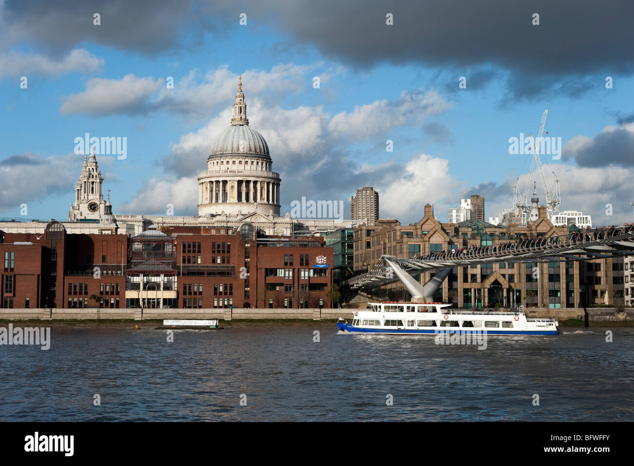 Tour boat on the river Thames passing St Paul's Cathedral, London, England, UK Stock Photo