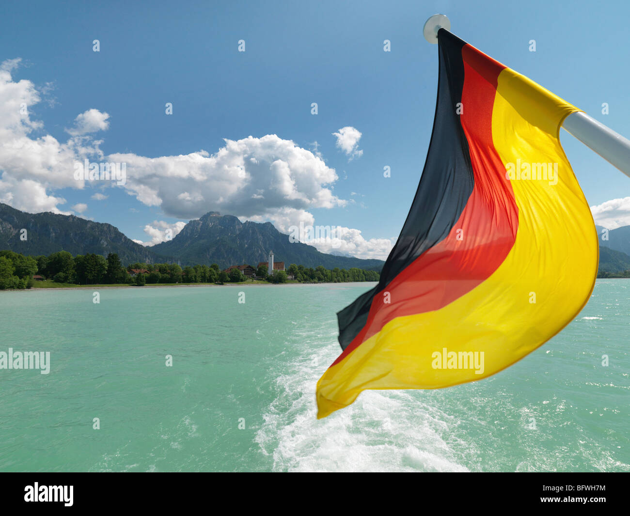 German national flag flying from pole Stock Photo