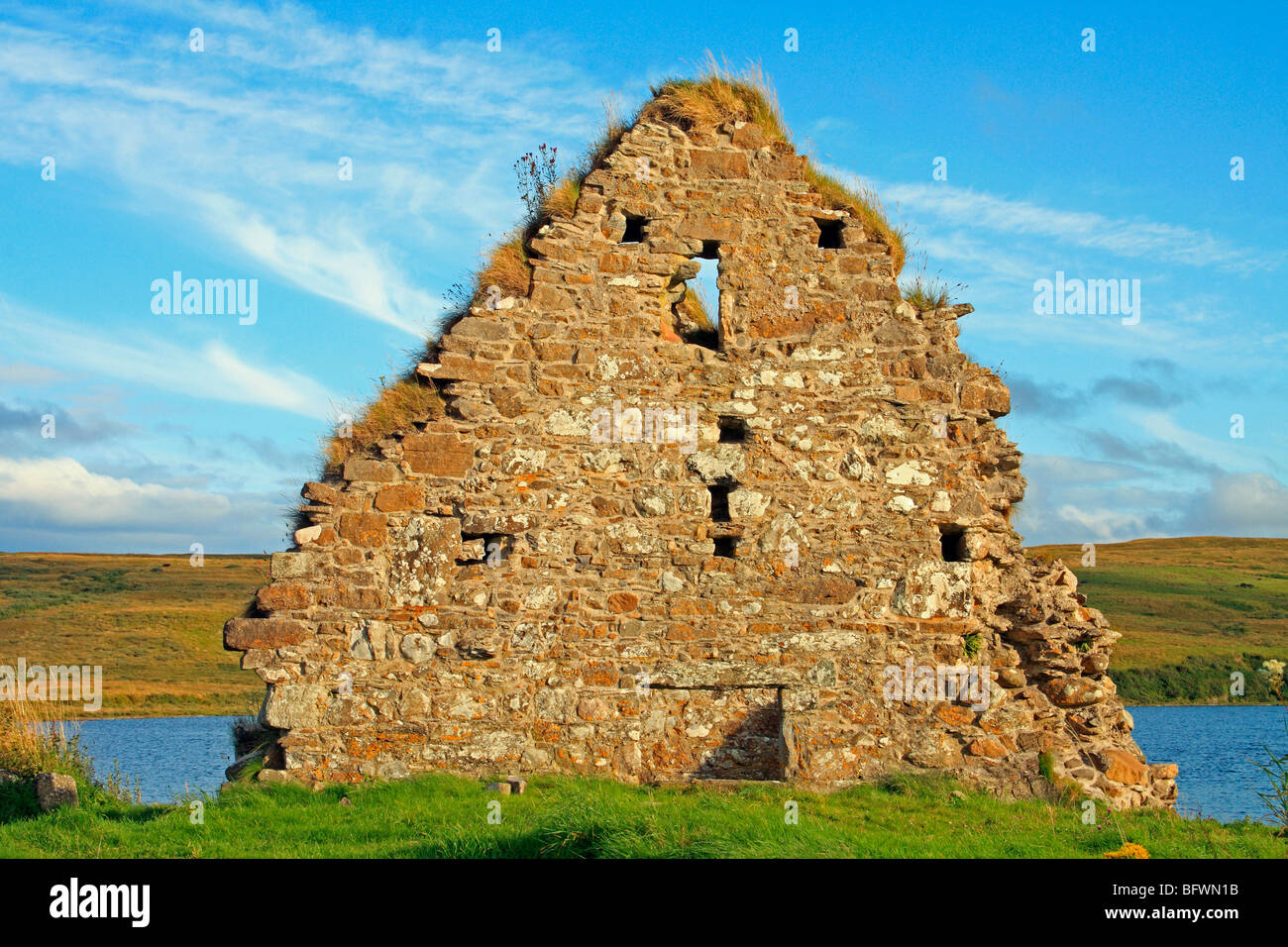 Ruins of a house at Finlaggan, once the seat of the Lords of the Isles. Islay, Scotland Stock Photo