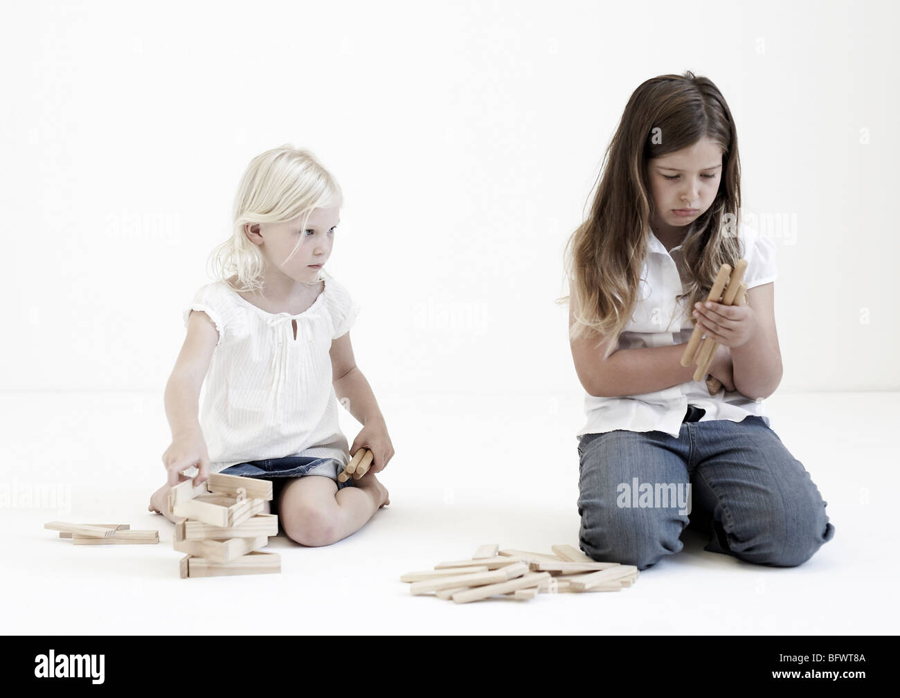 Young girls playing with building blocks - Stock Image