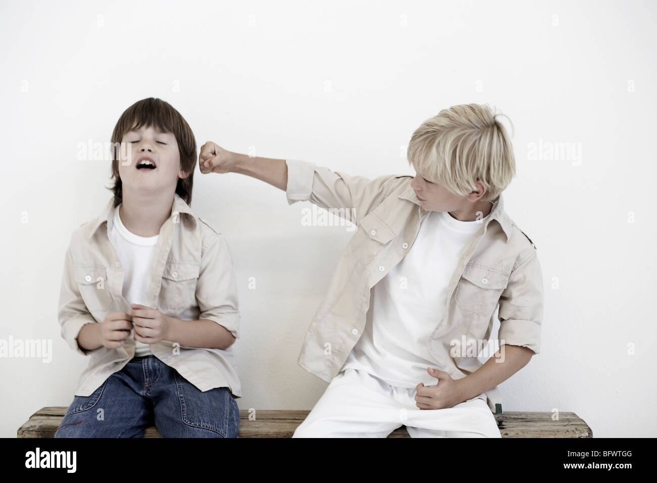 Young boys pretend fighting - Stock Image