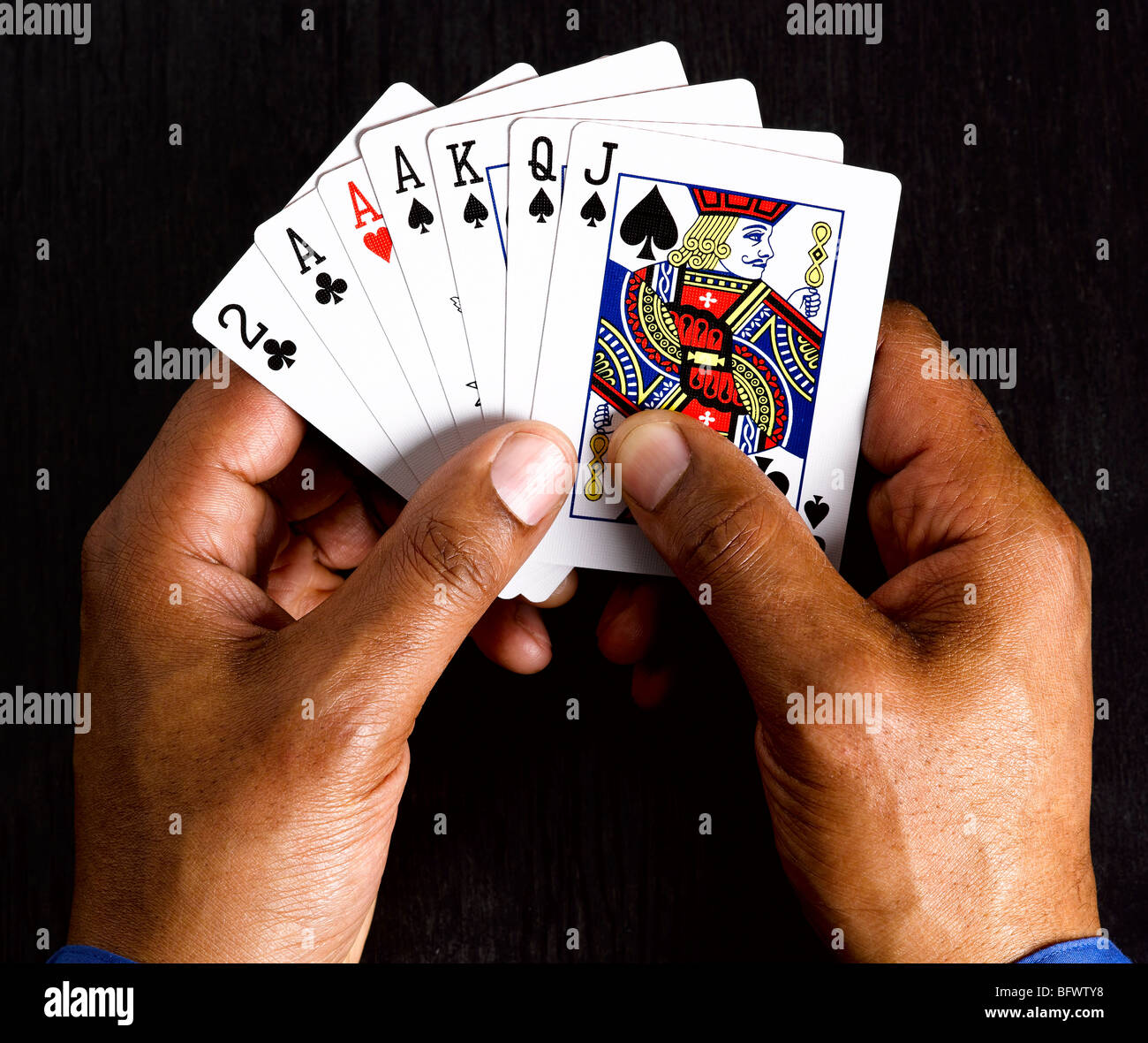 Business man with winning cards - Stock Image