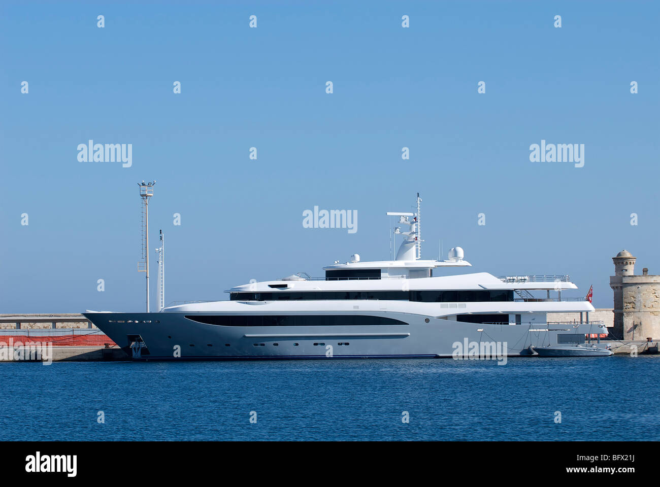 Luxury Yacht Anchored in port - Stock Image