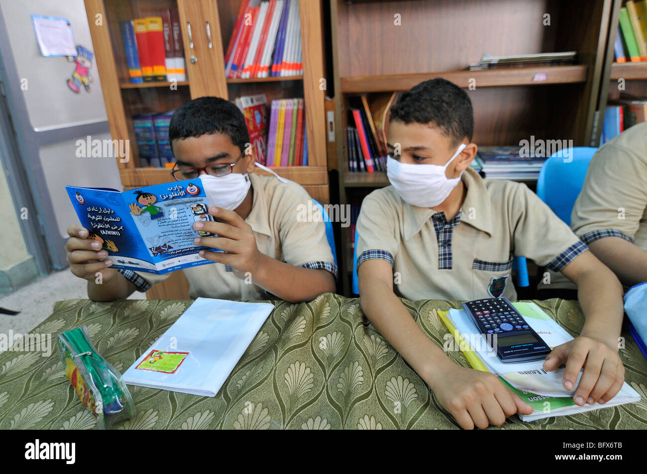 At schools in Egypt they have classes about swine flu as a prevention measure, with brochures and posters - Stock Image