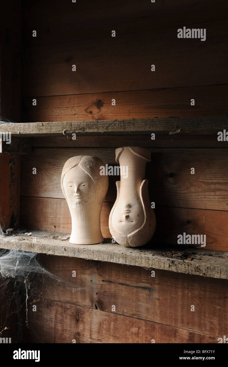 Poles Apart Stock Photos Images Alamy Anya Living Rs 004 5t Shoe Rack Grey Two Pot Heads Of Women Side By On Dusty Shelf One Head Stands Upside
