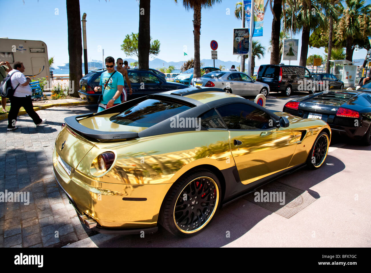 Gold Ferrari parked outside the Carlton Hotel, Cannes, Cote d'Azur, France - Stock Image
