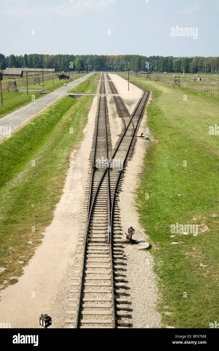 Railway lines leading inside from main entrance gate at Birkenau (Auschwitz II - Birkenau) Nazi death camp. Oswiecim, - Stock Image