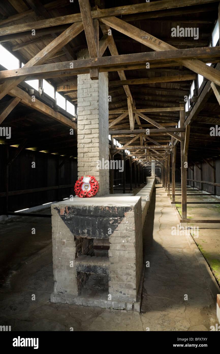 Inside a hut / shed – showing the heating fire – of the Birkenau (Auschwitz II - Birkenau) Nazi death camp in Oswiecim, - Stock Image