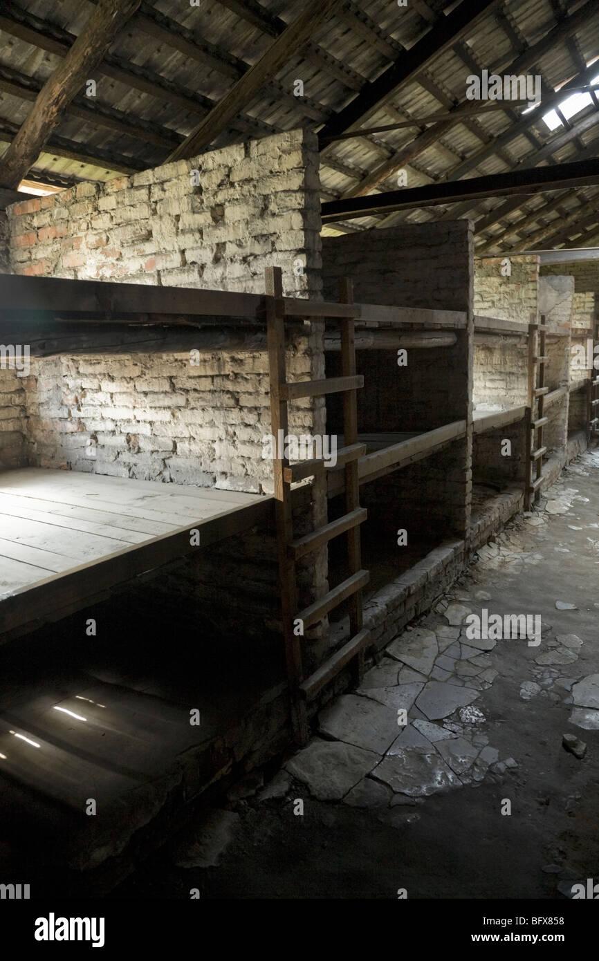Bunks for prisoners inside a hut (number 9)/ shed of the Birkenau (Auschwitz II - Birkenau) Nazi death camp in Oswiecim, - Stock Image